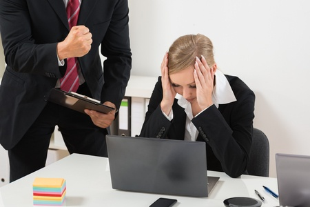 47217427 - boss with clipboard blaming to the female employee for bad results